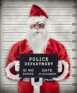 Mugshot of Santa Claus criminal under arrest.